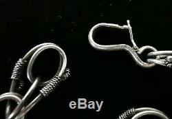 Bracelet ancien en argent massif avec des gros breloques