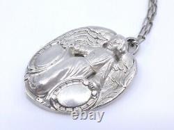 Grande médaille religieuse ancienne ange en argent massif XIXeme pendentif
